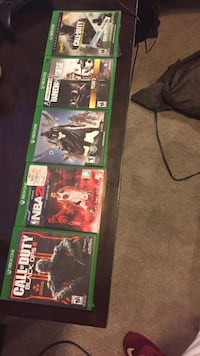 several assorted games Xbox One cases