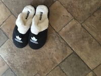Pair of white-and-black house slippers