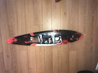 black and red skateboard deck