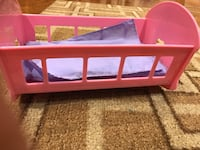 Doll bed & Frozen musical microphone sing along prices below Mississauga, L5V 1V3
