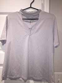Light grey shirt.