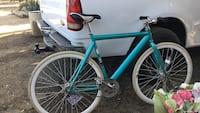 Teal and white double gear bike
