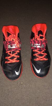 pair of black-and-red Nike basketball shoes Newark, 07107