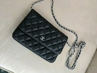 black and gray leather sling bag Winnipeg, R2J 0Y2