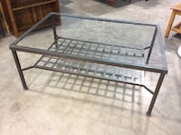"""Metal frame and glass top table. Measures 46 1/2"""" x 31"""" x 19"""" tall"""