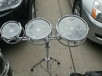 three stainless steel snare drums