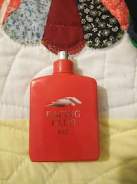 red and black perfume bottle Maryville, 37804