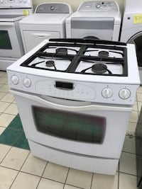 White JennAir Gas slide in stove in excellent working condition 100 days warranty  Baltimore, 21222