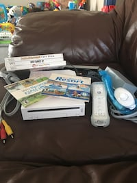 Nintendo Wii game console with all components and 5 games