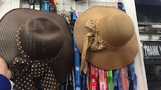 women's two black and brown hats