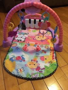 baby's pink and green activity center