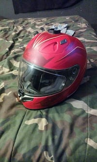 red and white full-face motorcycle helmet