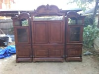 brown wooden TV hutch with flat screen television Fort Worth, 76111