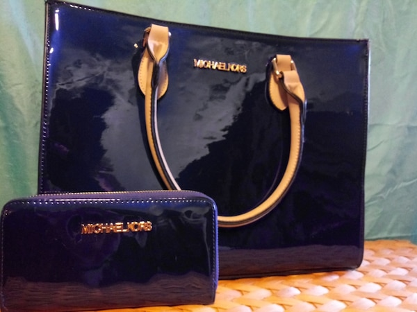cf0e3ec0cb72 Used black and brown Michael Kors leather handbag for sale in ...