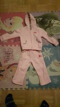 baby's pink and white footie pajama