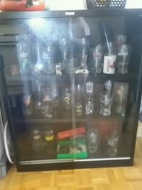 Glass display cabinet with over 60 pint glasses 522 km