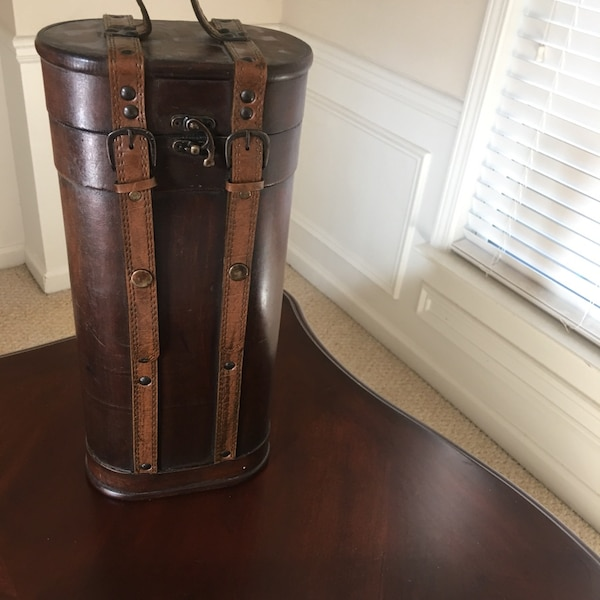 cylindrical brown wooden case