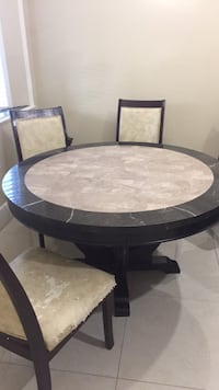 Round table granite with 4 chairs.. chairs rough shape  Surrey, V3V
