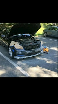 black and blue sports car 15 mi