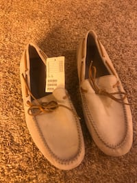 pair of beige leather boat shoes