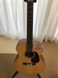 12 string guitar  bnib.   MARTIN 12 string incredible full sound !! Played maybe for 1 hr lol excellent new  Vancouver, V6H