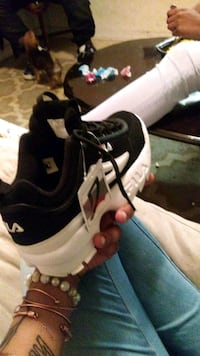 pair of black-and-white Nike running shoes 47 km