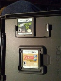 black Nintendo DS with game cartridge Edmonton, T5X 3W7