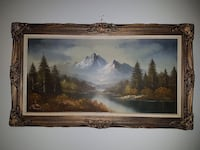 rectangular brown wooden framed with blue mountain painting