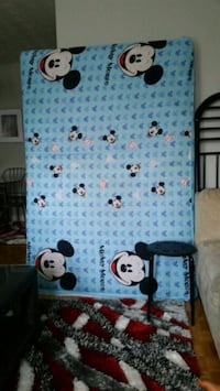 white and blue Mickey Mouse-themed bed frame 547 km