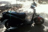 black and blue motor scooter