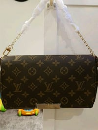 black and gray Louis Vuitton Monogram leather wristlet Edmonton, T5Y 3J2