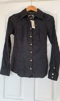 New Guess black blouse with tags attached. Size small.  Ajax, L1T 0K1