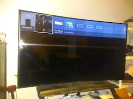 """65"""" curved smart TV with remote"""