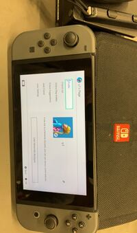 Nintendo Switch w/gray joycon and accessories