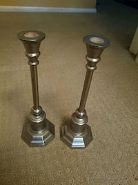 two stainless steel candle holders 17 mi