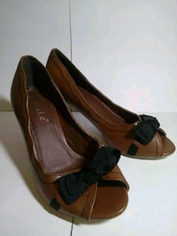 pair of brown leather peep-toe heeled shoes