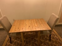 Table fold out sleeves and 3 suede chairs PRICE TO SELL