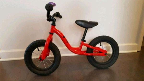 toddler's red and black bicycle