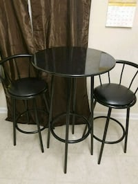 round black wooden table with four chairs Sandy Springs, 30328