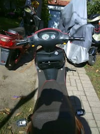 black and gray motor scooter Toronto, M4C 1L7