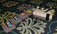 white Nintendo SNES with two controllers five cartridges