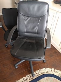 Black leather rolling arm chair