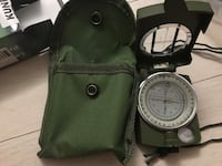 green and white compass with case New York, 10038
