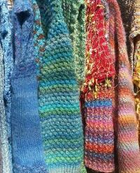 Hand knit sweaters and scarves 32 km