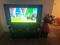 Tv stand and speaker only in all good condition we are moving Edmonton, T5T 0G6