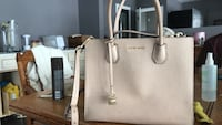 White leather michael kors tote bag price is negotiable Rosser