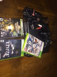 black Xbox 360 with controllers and game cases Washington, 20009