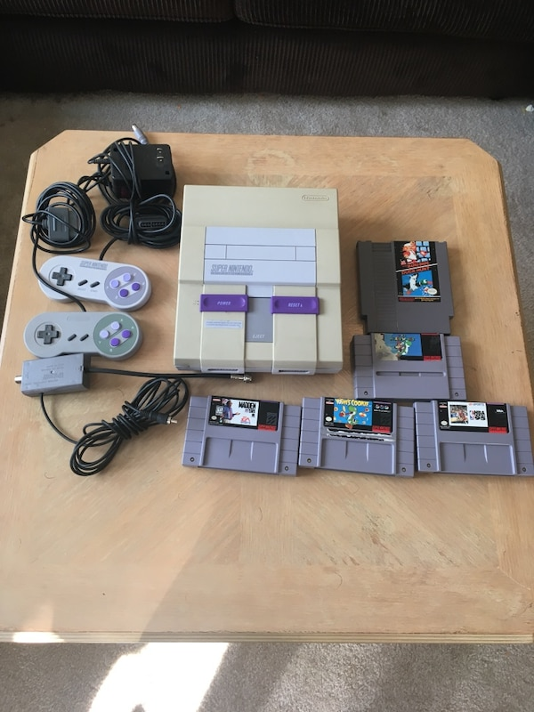 SNES game console with several cartridges