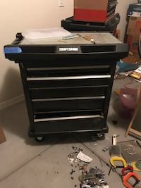 black and gray Craftsman tool cabinet