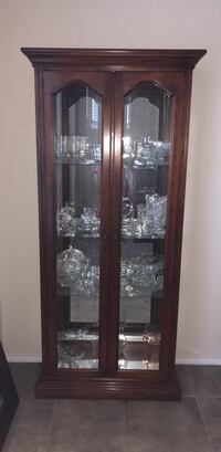 Brown wooden framed glass display cabinet North Richland Hills, 76180
